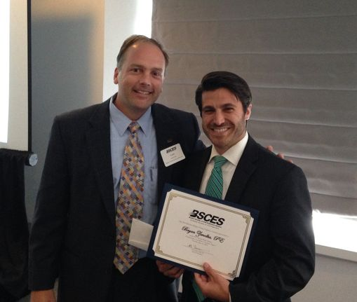 Bryan Zimolka (right) receives the 2015 Bertram Berger Young Engineer Award.